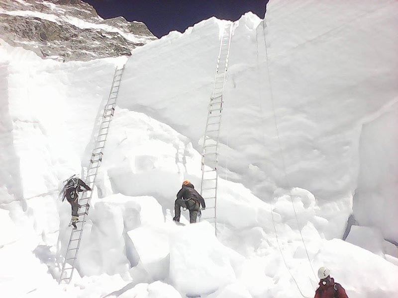 Icefall doctors preparing a climbing route along the treacherous section above the Base Camp on the way to Mt Everest for spring climbing. Photo courtesy: Nishan Shrestha / SPCC