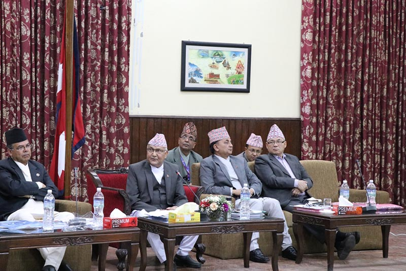 Prime Minister KP Sharma Oli (centre) addresses the National Reconstruction Authority's Advisory Council Meeting held at the PM's official residence in Baluwatar, Kathmandu, on Tuesday, April 3, 2018. Photo: NRA