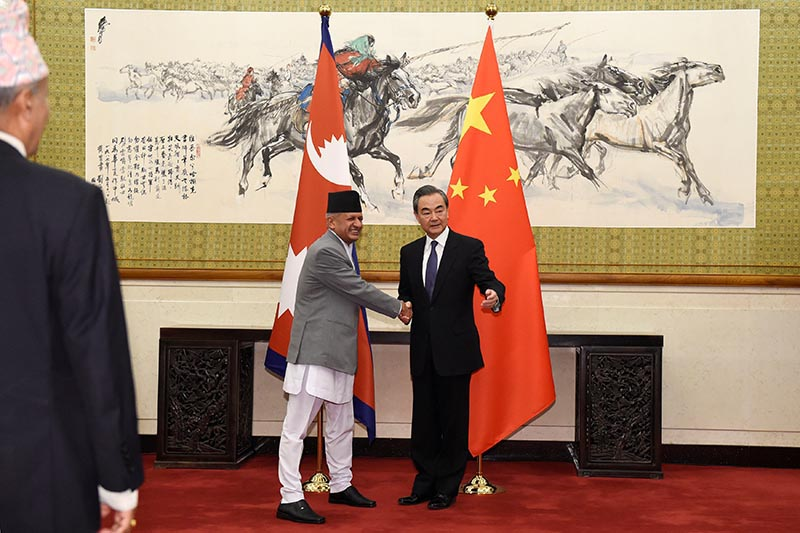 Nepal's  Minister for Foreign Affairs Pradeep Kumar Gyawali (left), shakes hands with his Chinese counterpart and State Counselor Wang Yi as they pose for media before their meeting, at the Diaoyutai State Guesthouse in Beijing, China, on Wednesday, April 18, 2018 . Photo: Parker Song/Pool via Reuters