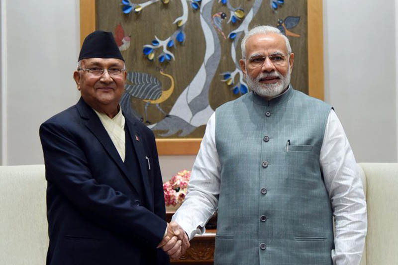 Prime Minister KP Sharma Oli shakes hand with his Indian counterpart Narnedra Modi, at latteru2019s official residence  at Lok Kalyan Marg, New Delhi, on Friday, April 6, 2018. Photo Courtesy: Narendra Modi's Twitter