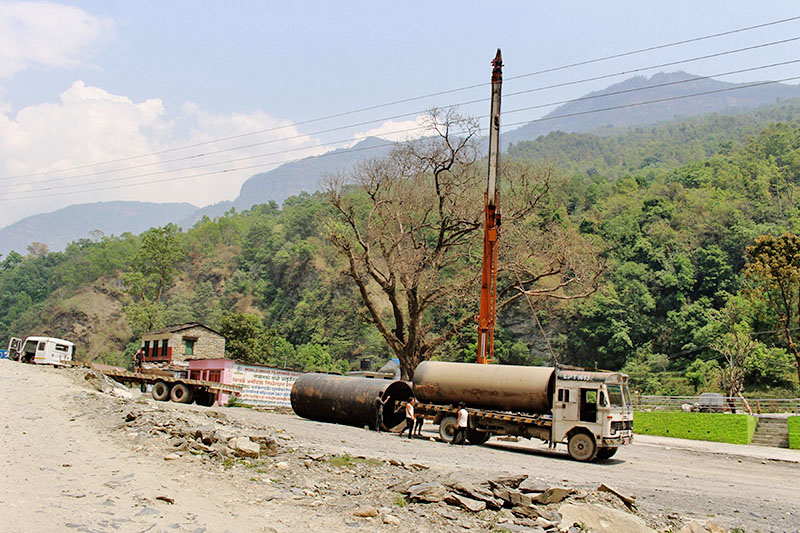Penstock pipes being delivered to an under-construction 42 mega watta Mistri khola hydro project in Myagdi district, on Friday, April 20, 2018. Photo: RSS