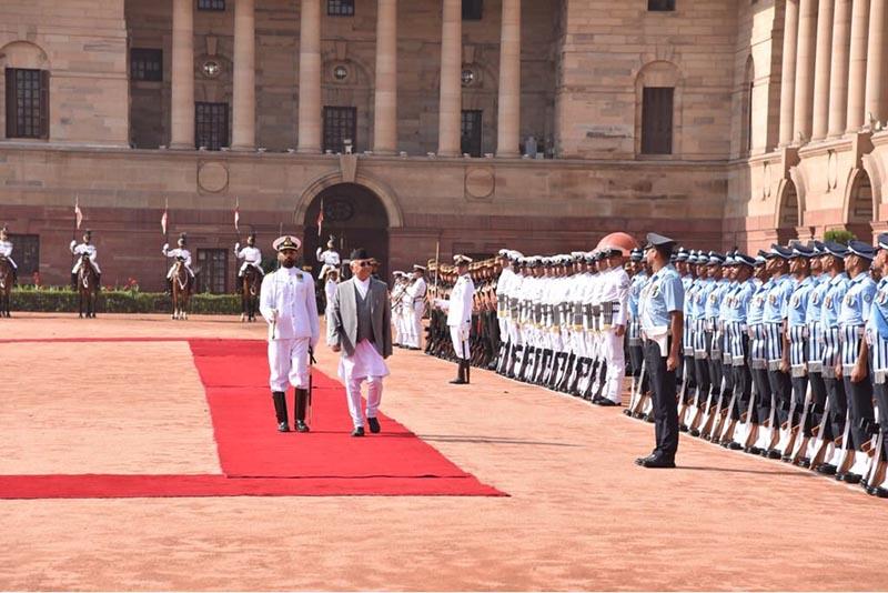 Prime Minister KP Sharma Oli receives a guard of honour at Rastrapati Bhavan in New Delhi, India, on Saturday, April 6, 2018. Photo: MEAIndia Twitter
