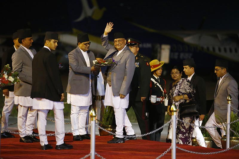 Prime Minister KP Sharma Oli being welcomed at TIA after returning from a three-day visit to India, in Kathmandu, on Sunday, April 8, 2018. Photo: Skanda Gautam/THT