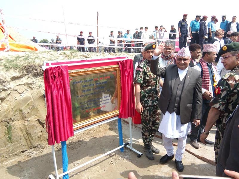 Prime Minister KP Sharma Oli laying the foundation stone of the garment processing area inside the Special Economic Zone in Jitpursimara sub-metropolis, Bara, on Sunday, April 1, 2018. Photo: THT