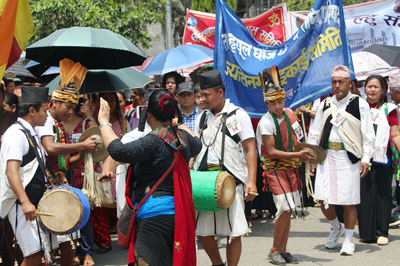 Members of indeginous community clad in their traditional attires are seen singing and dancing to the tunes of music beats as they take part in procession at the historic Jeetgadi Fort in Butwal Sub-Metropolitan City, on Friday, April 20, 2018. Photo: RSS