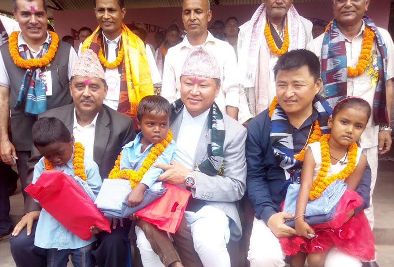 Province 1 Chief Minister Sherdhan Rai posing for photographs after taking guardianship of three children in Ratuwamai Municipality, Morang, on Sunday, April 22, 2018. Photo: THT