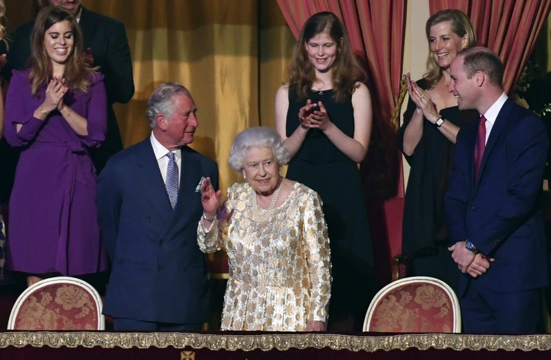 Britainu2019s Queen Elizabeth II, surrounded by members of the royal family, takes her seat at the Royal Albert Hall in London on Saturday April 21, 2018, for a concert to celebrate the 92nd birthday of Queen Elizabeth II. Photo: APn