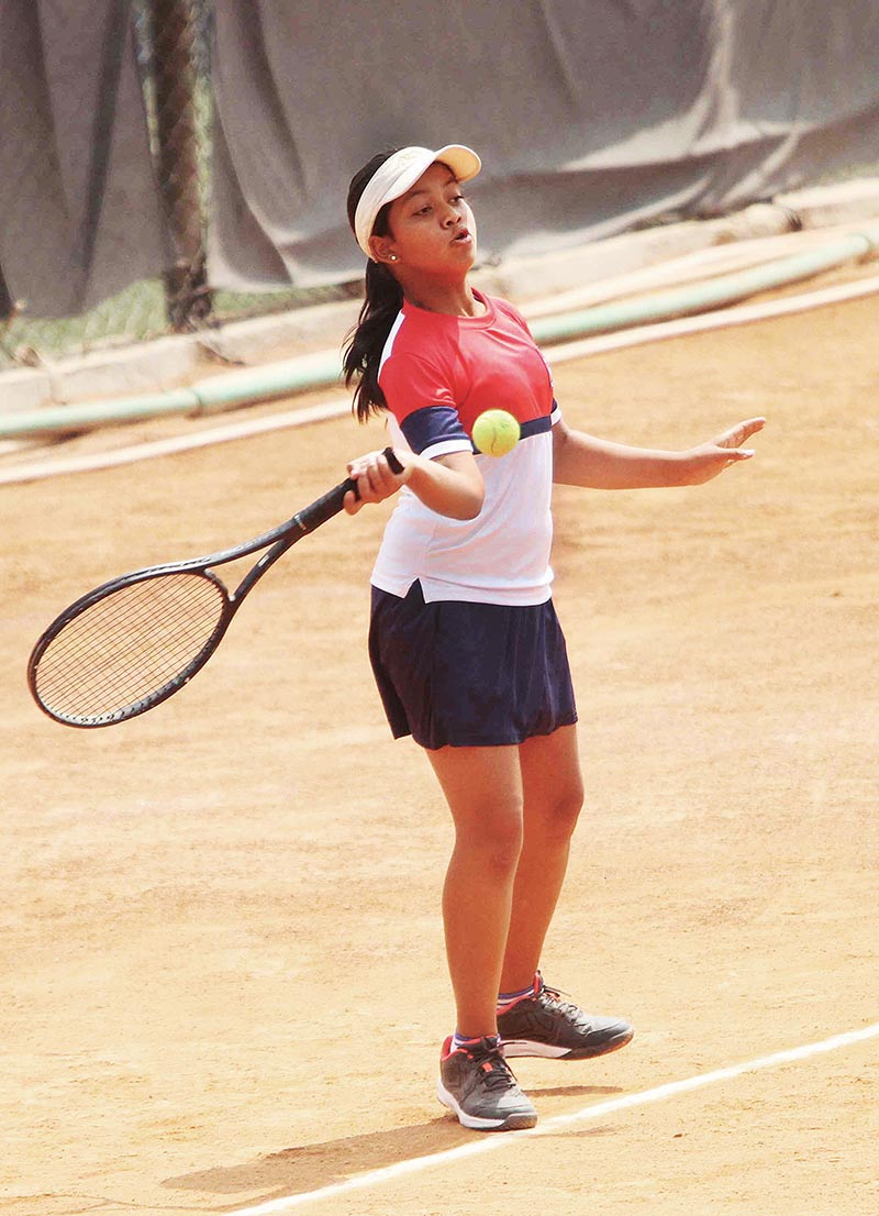 Subhangee Laxmi Shah of Nepal returns to Hasali Gajba of Sri Lanka in girl's singles round robin match during their South Asia Regional Qualifying tennis tournaments at Tennis Complex, Satdobato in Lalitpur on Tuesday. Photo: THT
