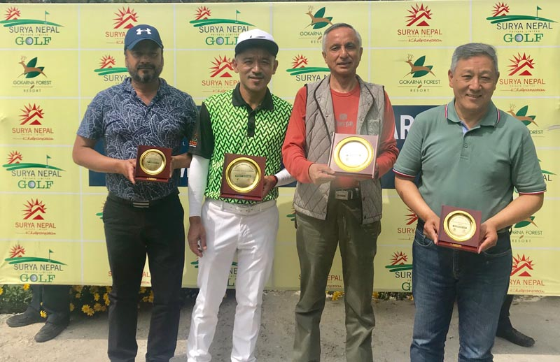 (From left) Devendra Bajgai, Tashi Tshiring, Prabhakar Adhikari and Ang Dendi Sherpa hold their trophies after the Surya Nepal Gokarna Monthly Medal at the Gokarna Golf Club in Kathmandu on Saturday, March 31, 2018. Photo: THT