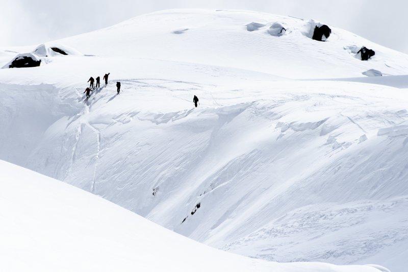 Rescue crews walk at an avalanche site near Fiesch, Switzerland, on Sunday, April 1, 2018. Photo: AP