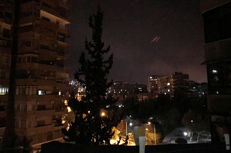 Anti-aircraft fire is seen over Damascus, Syria, early on Saturday, April 14, 2018. Photo: REUTERS