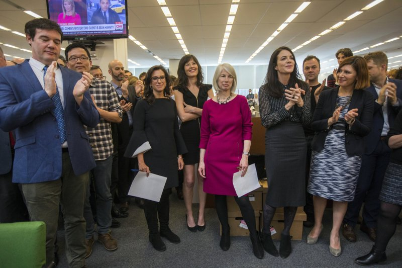File - Beginning third from left, New York Times staff writers Jodi Kantor and Megan Twohey, senior enterprise editor Rebecca Corbett and reporter Cara Buckley celebrate with colleagues in the newsroom in New York after the team they led won the 2018 Pulitzer Prize for Public Service on Monday, April 16, 2018. Photo: AP