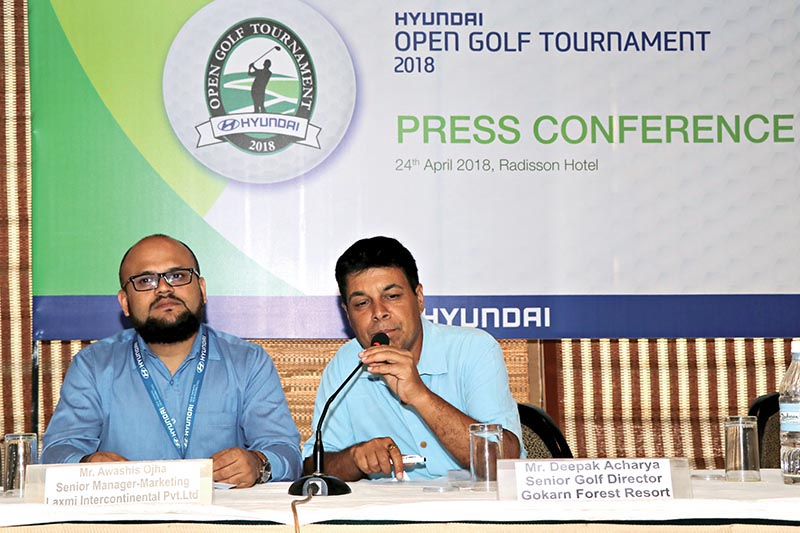 Sr Golf Director of Gokarna Forest Resort Deepak Acharya speaks as Sr Manager-Marketing at Laxmi Intercontinental Awashis Ojha looks on during a press meet in Kathmandu on Tuesday. Photo: THT