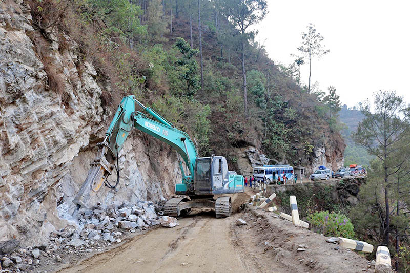 A heavy equipment being used to drill base rocks for road expansion along Jayaram-Halesi road section in Khotang district, on Sunday, April 15, 2018. Meanwhile, road expansion, black topping and sewer work is being carried out on 40 km long road strech. Photo: RSS