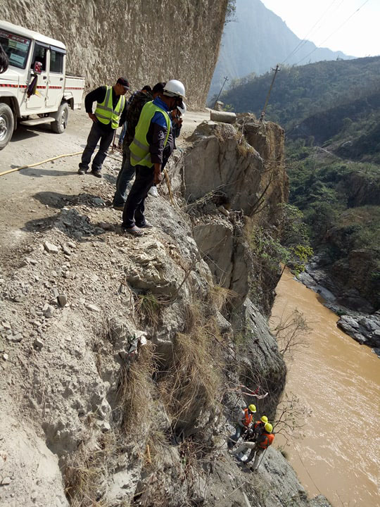 Construction workers carrying out road widening works through rod anchoring method at a narrow area of the Narayangadh-Muglin road section, on April 19, 2018. Photo: Tilak Ram Rimal