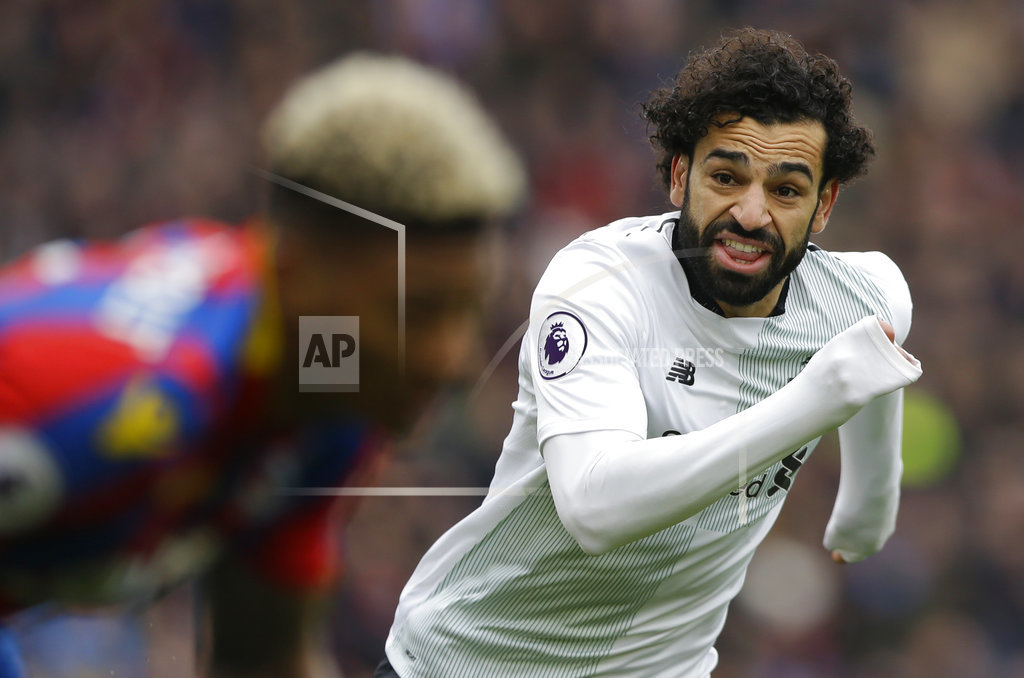 FILE - In this Saturday, March 31, 2018 file photo, Liverpool's Mohamed Salah runs past Crystal Palace's James Tomkins during the English Premier League soccer match between Crystal Palace and Liverpool at Selhurst Park stadium in London. Liverpool is set to play a 4-3-3 formation with free-scoring forward Mohamed Salah the star player this season, during the Champions League soccer final against Real Madrid on Saturday, May 26, 2018. (AP Photo/Alastair Grant, File)