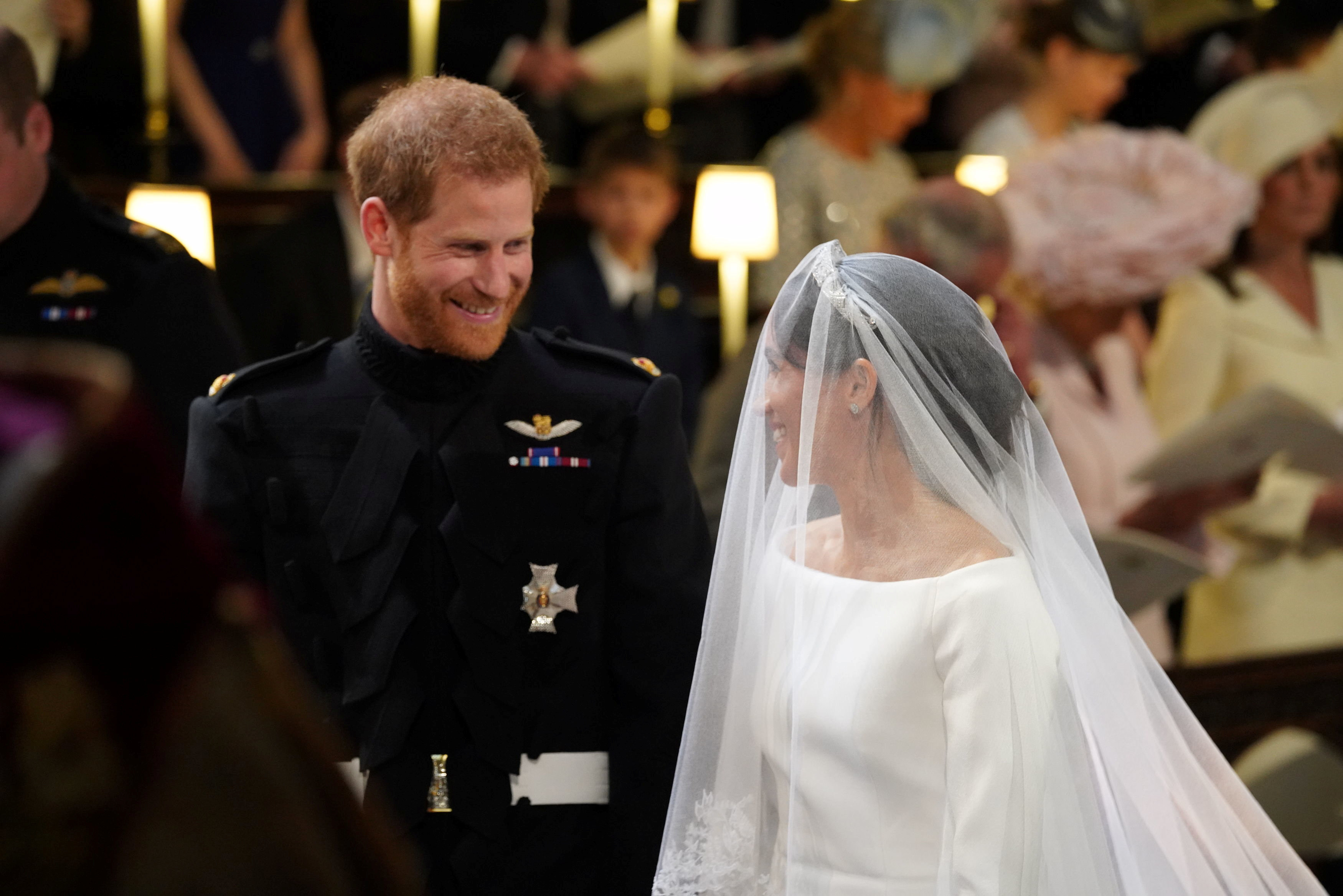 Prince Harry looks at his bride, Meghan Markle, as she arrives accompanied by the Prince of Wales in St George's Chapel at Windsor Castle for their wedding, in Windsor, Britain, on May 19, 2018. Photo: Reuters