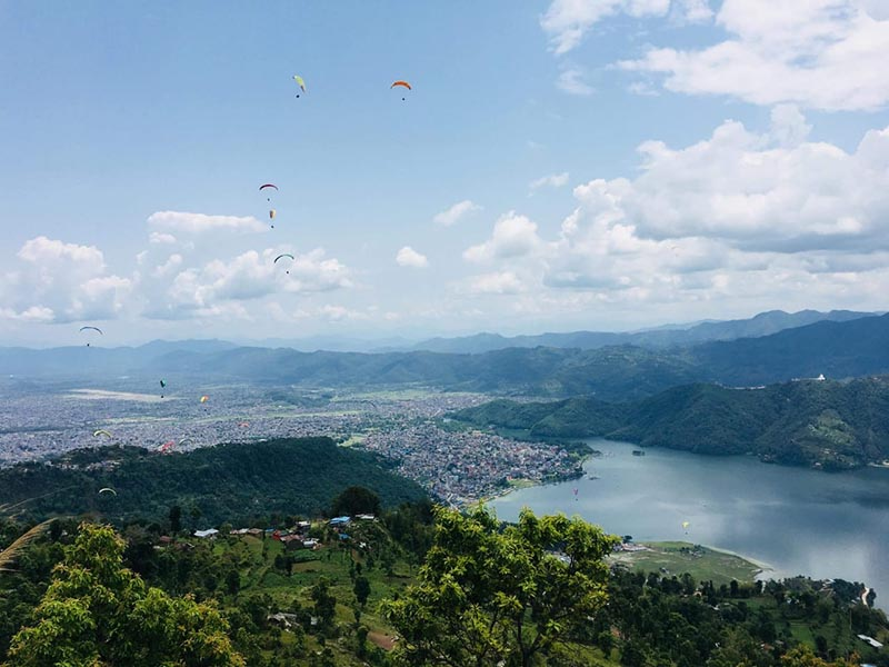 A view of paragliders taking parachute flight in the skies over Phewa Lake, from Sarangkot, in Pokhara, Kaski district, on Wednesday, May 16, 2018. Photo Courtesy: Surya Paudel