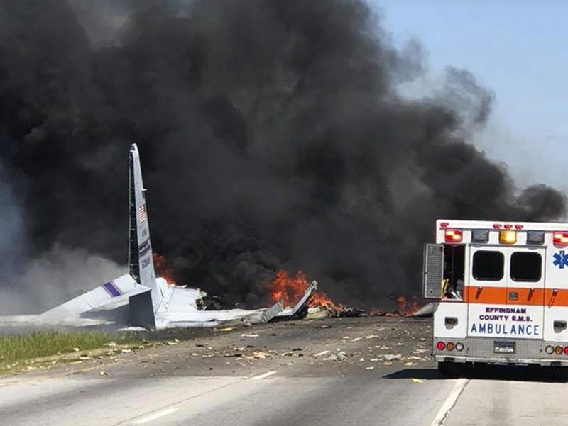 Flames and smoke rise from an Air National Guard C-130 cargo plane after it crashed near Savannah, Ga., on Wednesday, May 2, 2018. Photo: James Lavine via AP