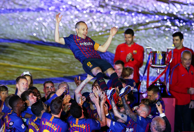Barcelona's Andres Iniesta and team mates celebrate after the La Liga match between FC Barcelona and Real Sociedad, at Camp Nou, Barcelona, Spain, on  May 20, 2018. Photo: Reuters