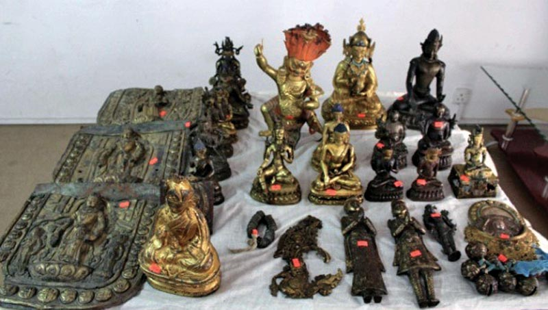 Artefacts and idols seized by police put on display at Central Investigation Bureau, in Kathmandu, on Sunday, May 6, 2018. Photo: AP