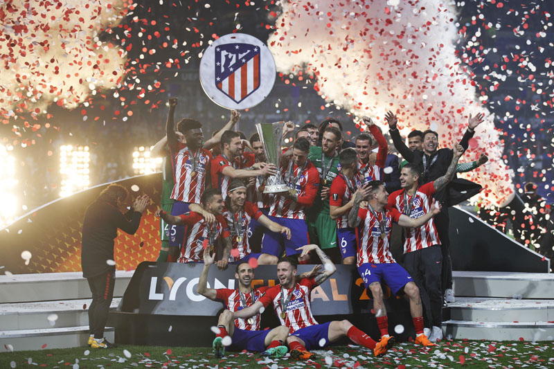 Atletico Madrid players celebrate with the trophy after winning the Europa League Final  match between Marseille and Atletico Madrid at the Stade de Lyon, Lyon, France, on  Wednesday, May 16, 2018. Photo: Associated Press
