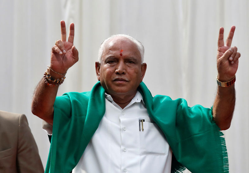 File Photo: BJP leader B. S. Yeddyurappa flashes the victory sign after taking oath as Chief Minister of the southern state of Karnataka inside the governor's house in Bengaluru, India, May 17, 2018. Photo: Reuters