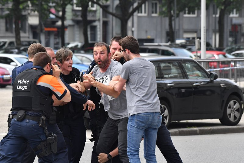 Police try to calm a man at the scene of a shooting in Liege, Belgium, on Tuesday, May 29, 2018. Photo: AP