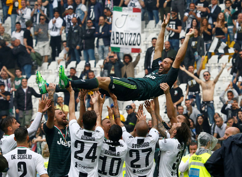 Juventus' Gianluigi Buffon is lifted up by his team mates in celebration of winning the league and his final appearance for Juventus, at Allianz Stadium, in Turin, Italy, on May 19, 2018. Photo: Reuters