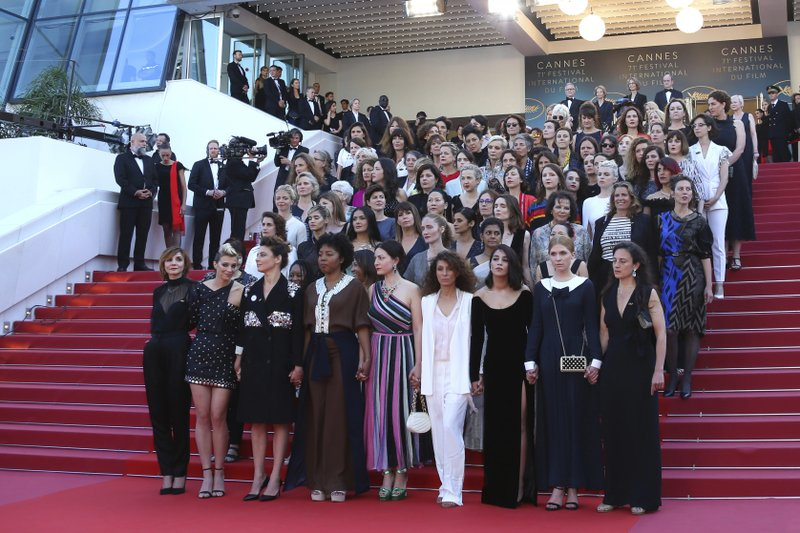 Eighty two film industry professionals stand on the steps of the Palais des Festivals to represent, what they describe as pervasive gender inequality in the film industry, at the 71st international film festival, Cannes, southern France, on Saturday, May 12, 2018. Photo: AP