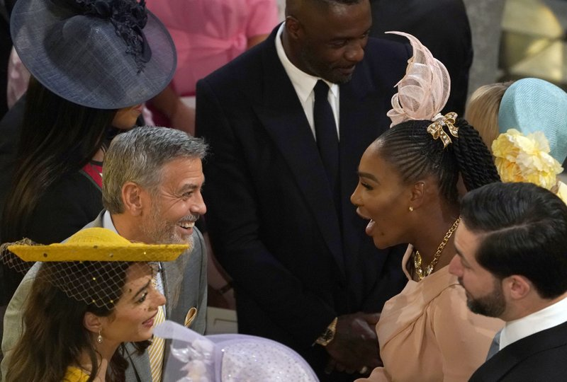 George Clooney, center left, greets Serena Williams in St. Georgeu2019s Chapel at Windsor Castle for the wedding of Prince Harry and Meghan Markle in Windsor, England on Saturday, May 19, 2018. Photo: AP