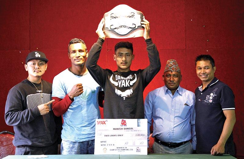 Manish Dangol celebrates with the Champ of the Champions belt n Kathmandu on Monday. THT
