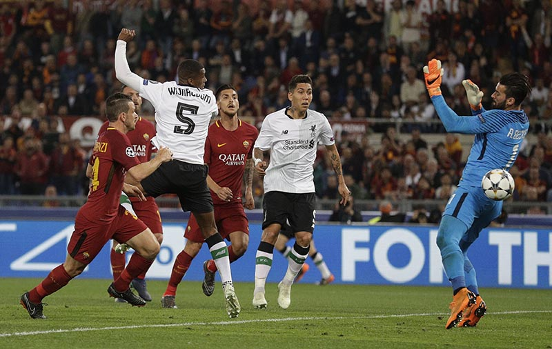 Liverpool's Georginio Wijnaldum scores his side's second goal during the Champions League semifinal second leg soccer match between Roma and Liverpool at the Olympic Stadium in Rome, on Wednesday, May 2, 2018. Photo: AP