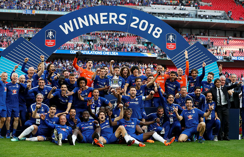 Chelsea celebrate winning the final with the trophy after winning FA Cup Final between Chelsea and Manchester United, at Wembley Stadium, in London, Britain, May 19, 2018. Photo: Reuters