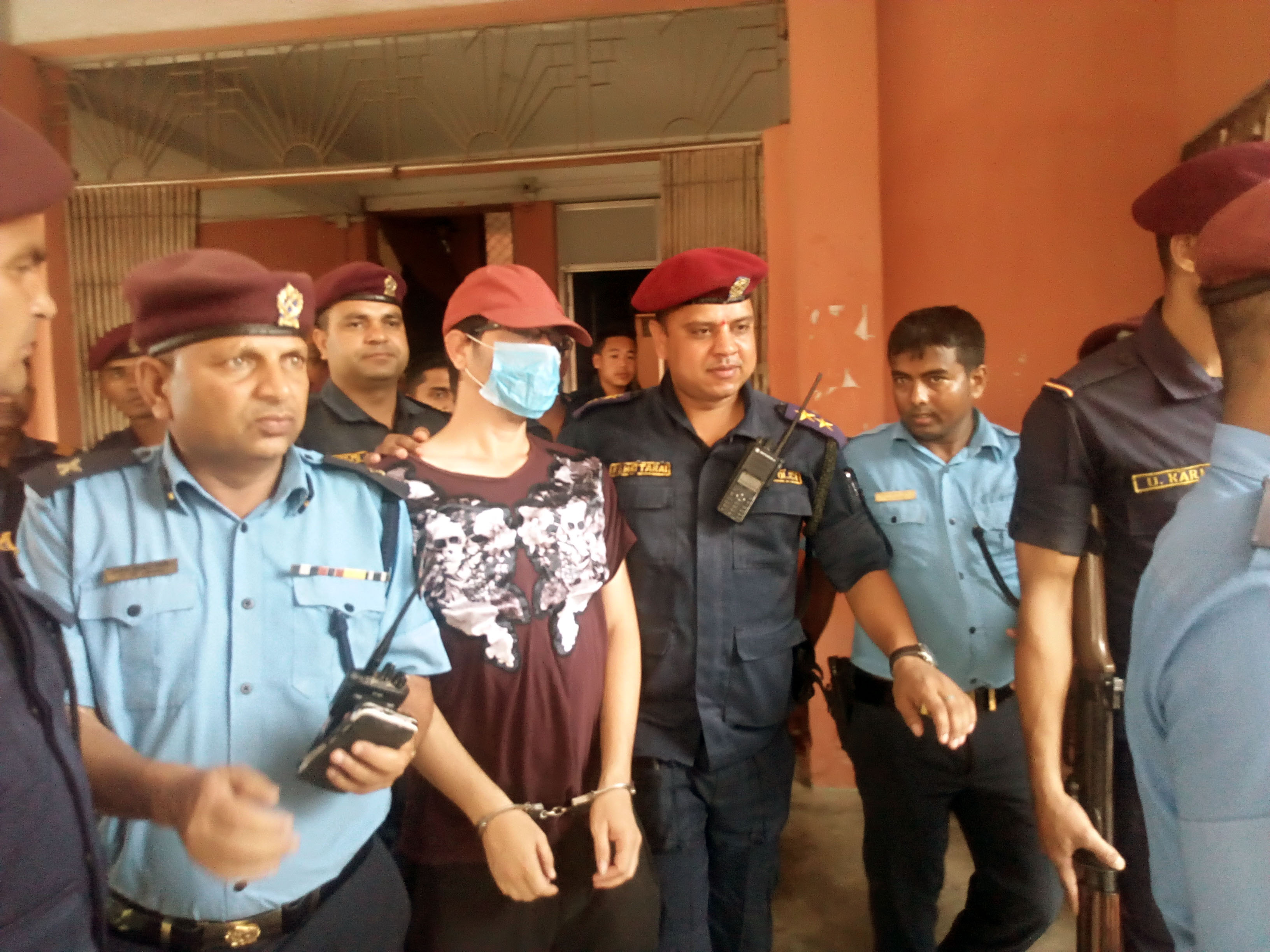 Police Officers are seen at the premises of District Court, Morang taking the alleged mastermind of the gold smuggling and murder case, Chudamani Upreti (Gorey) back to custody at District Police Office after the court recorded his statement on Friday, May 25, 2018. Photo: Hari Adhikari