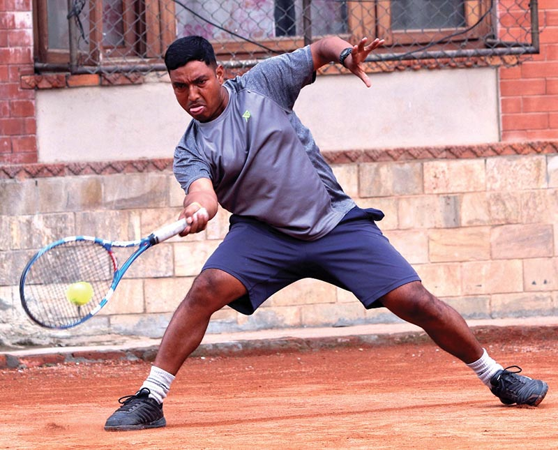 Jitendra Pariyar returns to Pranav Khanal during their men's singles quarter-final of the sixth  Citizens Bank Open Tennis Tournament in Kathmandu on Monday. THT