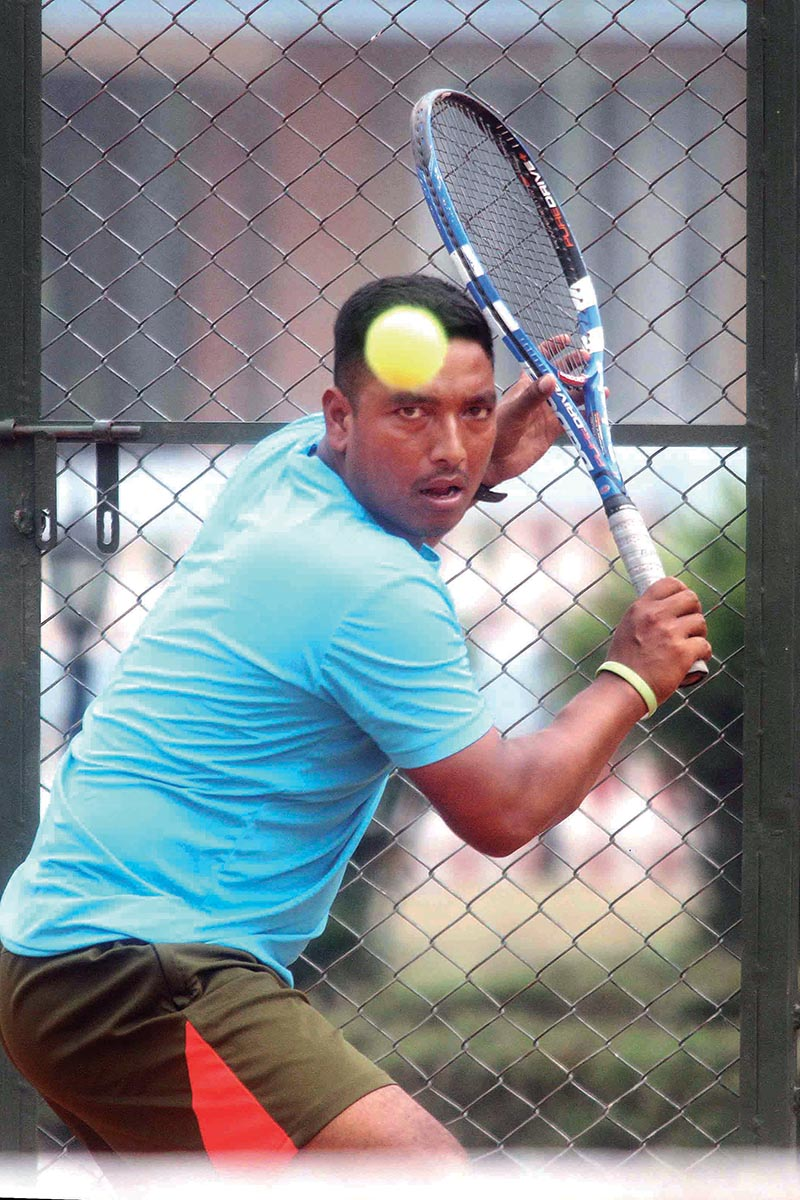 Jitendra Pariyar returns to Pradip Khadka during their menu2019s singles semi-final match of the sixth Citizens Bank Open in Kathmandu on Wednesday. Photo: THT