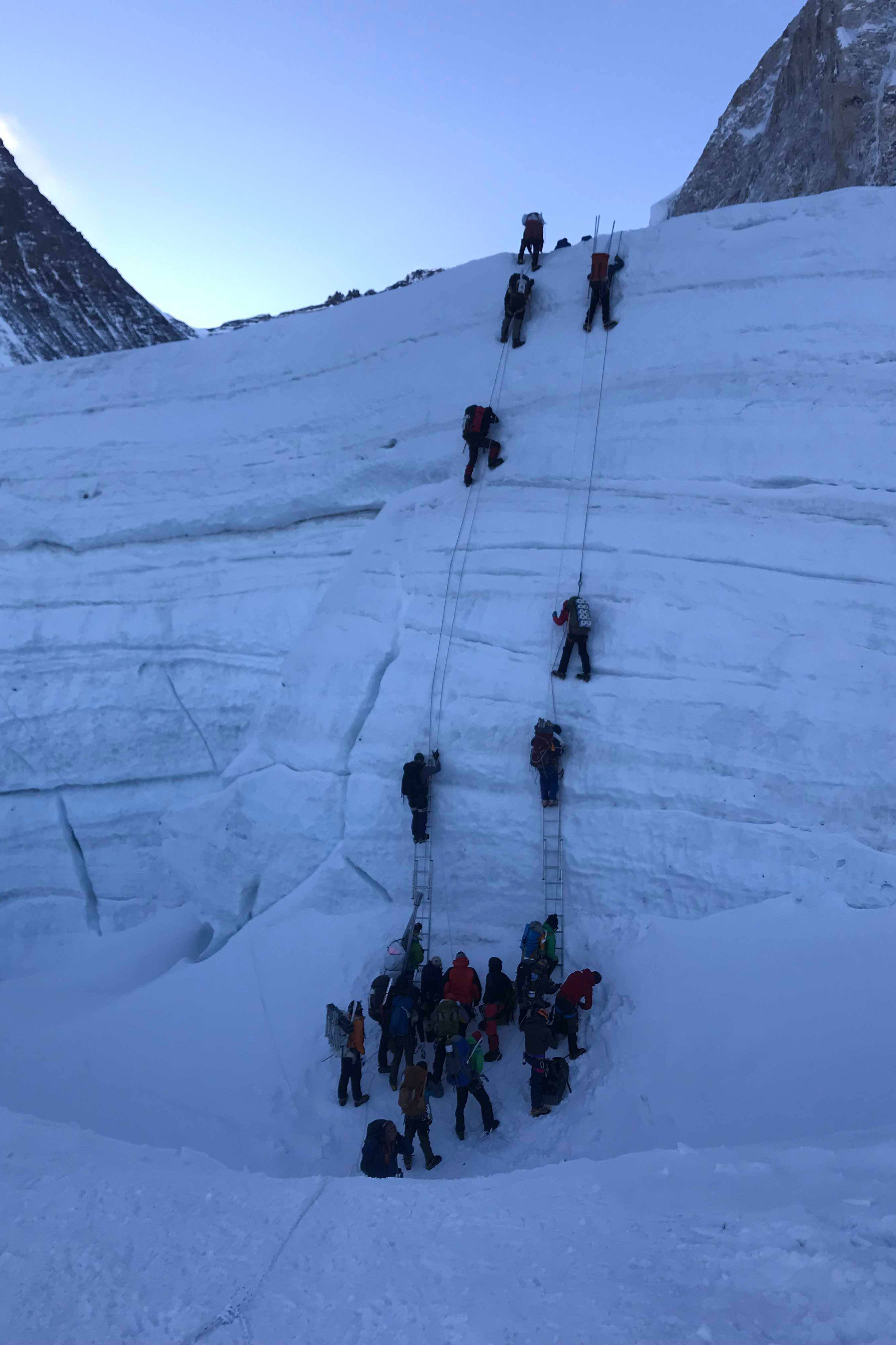 Climbers crossing icefall section on Mt Everest.