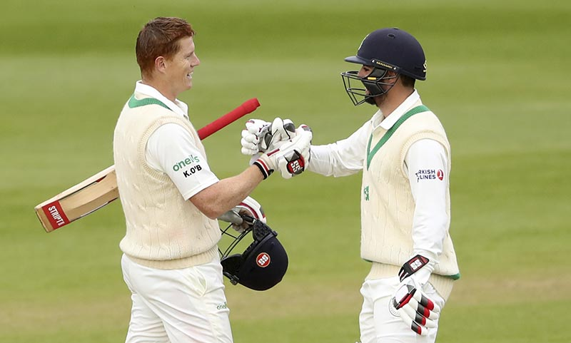 Ireland's Tyrone Kane (right), congratulates teammate Kevin O'Brien on his Test Century on day four of the International Test Match against Pakistan at The Village in Dublin, Ireland, on Monday, May 14, 2018. Photo: Niall Carson/PA via AP