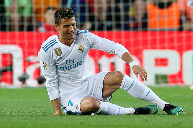 Real Madrid's Cristiano Ronaldo goes down after sustaining an injury. Photo: Reuters