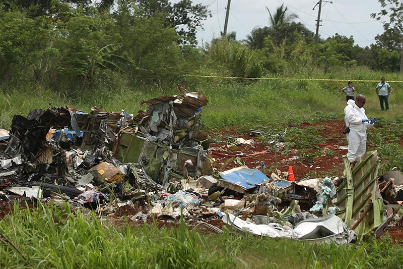 A rescue team member works at the wreckage of a Boeing 737 plane that crashed in the agricultural area of Boyeros, around 20 kilometres (12 miles) south of Havana, shortly after taking off from Havana's main airport in Cuba, on Friday, May 18, 2018. Photo: Reuters