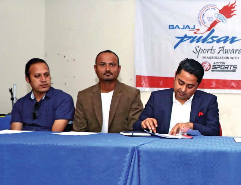 Dish Media Network Limited CEO Sudeep Acharya  signing the MoU as NSJF senior vice-president Durganath Subedi (centre) and vice-president Shreelochan Rajopadhyaya look on during a meet in Kathmandu on Thursday, May 10, 2018. Photo: THT