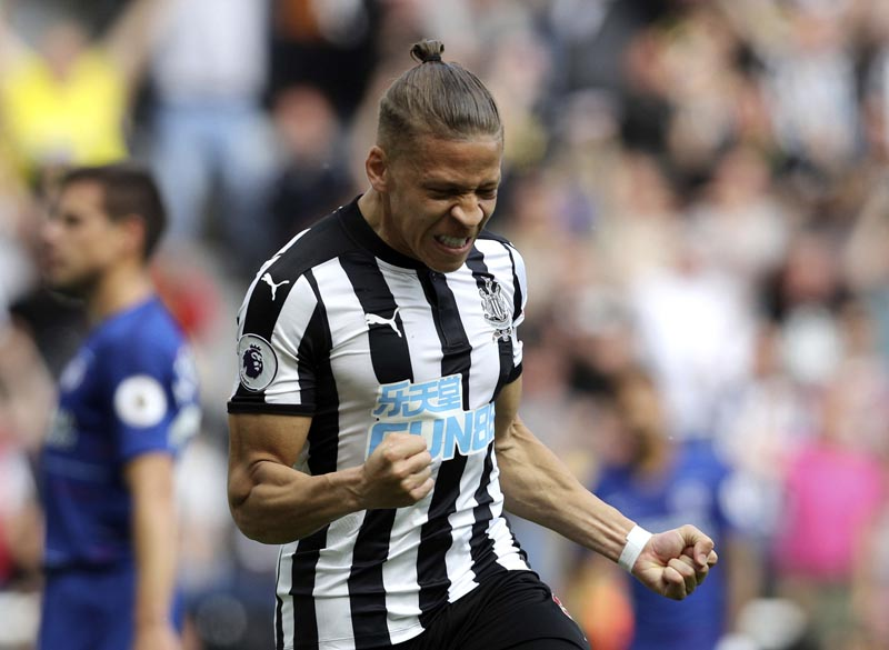 Newcastle United's Dwight Gayle celebrates scoring his side's first goal of the game, during the English Premier League  match between Newcastle United and Chelsea at St James' Park,  Newcastle, England, on Sunday May 13, 2018. Photo: Associated Press