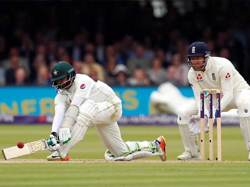 Pakistan's Azhar Ali in action as England's Jonny Bairstow looks on. Photo: Reuters