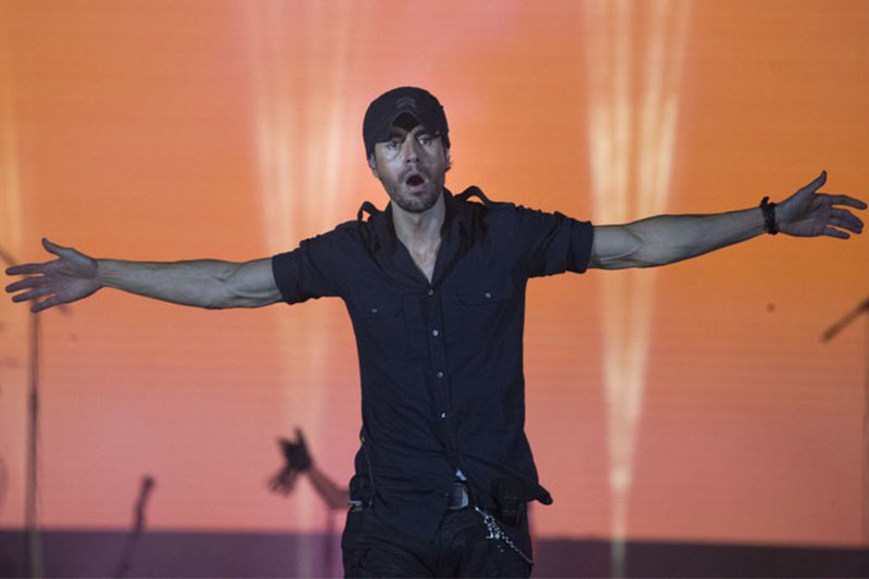 Spanish singer Enrique Iglesias performs on stage in Tel Aviv, Israel, on Sunday, May 27, 2018. Photo: AP