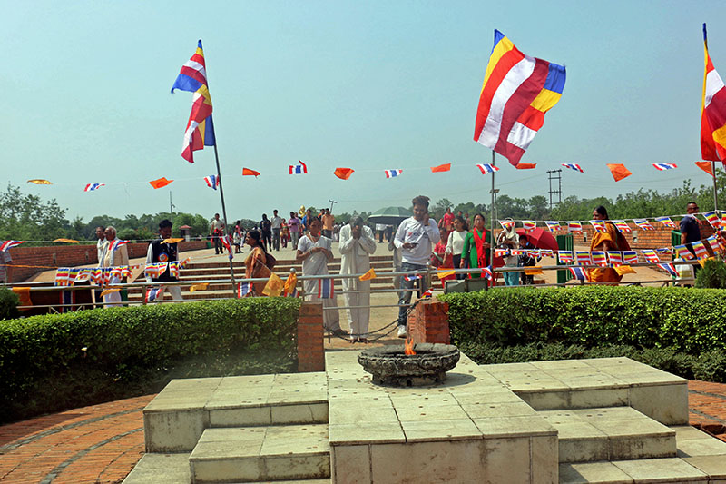 Visitors offering prayers at Eternal Peace Lamp next to Mayadevi Temple in Lumbini area, on Tuesday, May 08, 2018. Photo: RSS