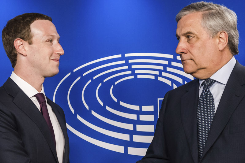 European Parliament President Antonio Tajani, right, welcomes Facebook CEO Mark Zuckerberg upon his arrival at the EU Parliament in Brussels, on Tuesday, May 22, 2018. Photo: Associated Press