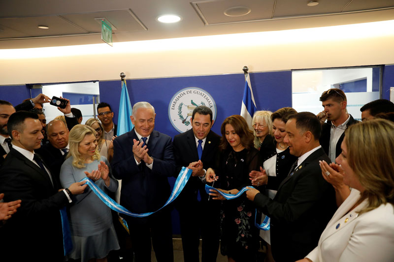 Hilda Patricia Marroquin, the wife of Guatemalan President Jimmy Morales, cuts the ribbon during the dedication ceremony of the embassy of Guatemala in Jerusalem, on Wednesday,16 May, 2018. Photo: Reuters