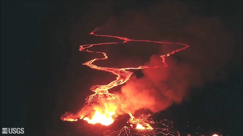 This May 22, 2018 photo from video from an unpiloted aircraft provided by the US Geological Survey, shows flow from what scientists call fissure 22 as lava from Kilauea Volcano continues to flow into the ocean, top, near the town of Pahoa, Hawaii. Photo: APn