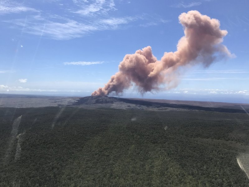 In this photo provided by the US Geological Survey, red ash rises from the Puu Oo vent on Hawaiiu2019s Kilauea Volcano after a magnitude-5.0 earthquake struck the Big Island, on Thursday, May 3, 2018 in Hawaii Volcanoes National Park. Photo: AP
